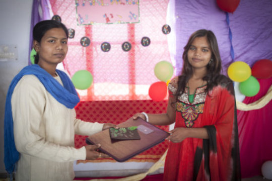 Maya(12th Grade) receiving prize from her teacher