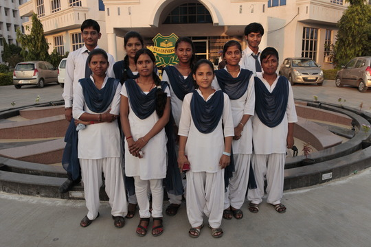 Pushpa, front row, second from the left