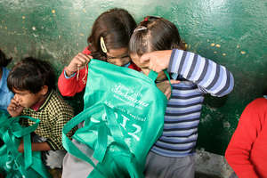 Girls looking into their newyear treasure bag!