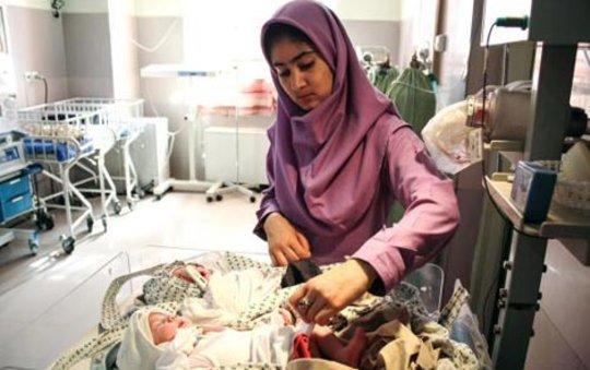 Tayibe Shafiq cares for a newborn
