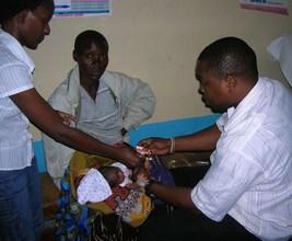 Nurses treating an ill newborn