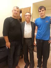 Mansur (on the right) with his dad and his surgeon