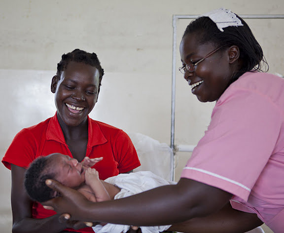 Esther Madudu with mother and newborn