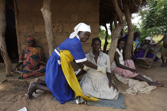 An AMREF midwife at work
