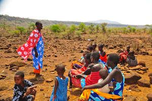 Health Worker Educates Group of Mothers in Kenya