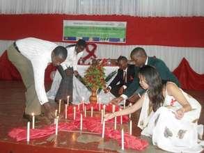participants light candles