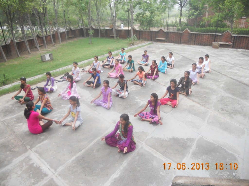 Girls doing Yoga at the residential camp