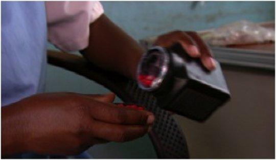 A nurse dispensing HIV medication