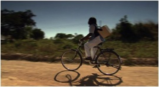 A nurse cycling to villages