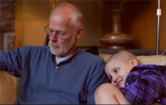 Trinity and her grandpa at the Caring Cabin