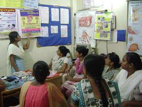 Girls attend a heath education class.