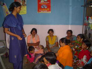 A girl leader educating women
