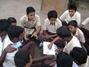 Boys preparing for a community awareness program