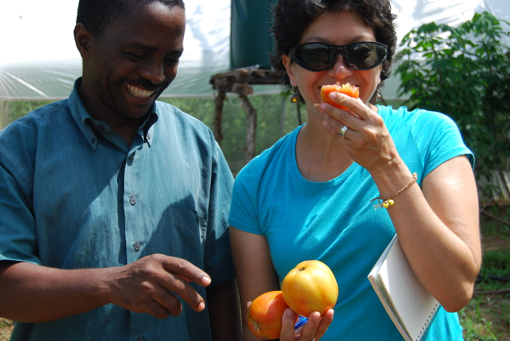 Me tasting a tomato from a greenhouse...yum!