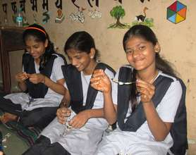 Girls learn to make ornaments from paper