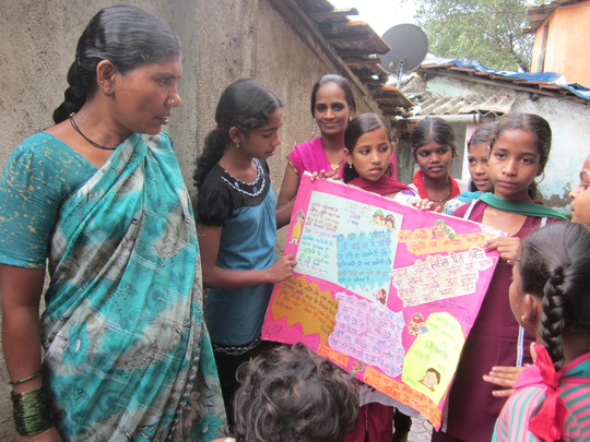 Girls discussing their wall paper in community