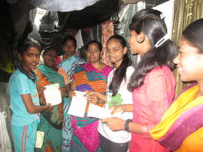 Girls disseminating leaflets on their rights