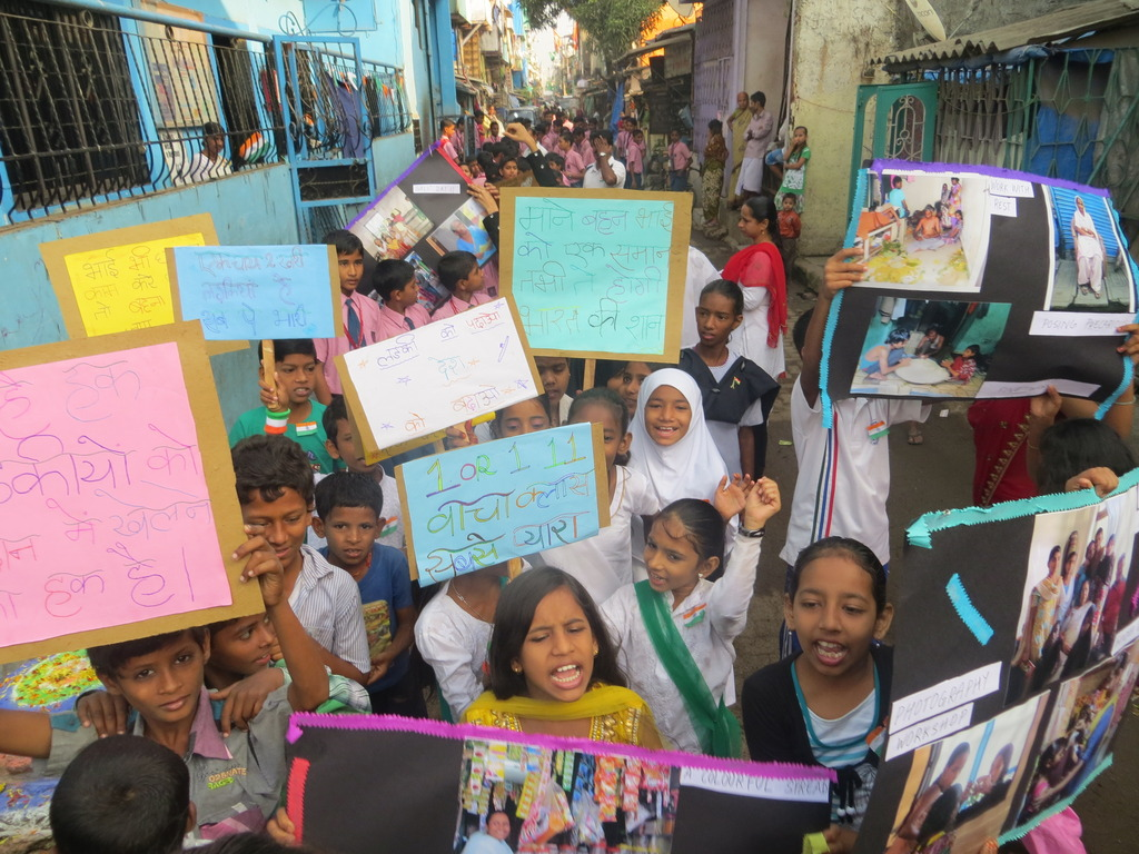 Girls shouting slogans at rally organised by them
