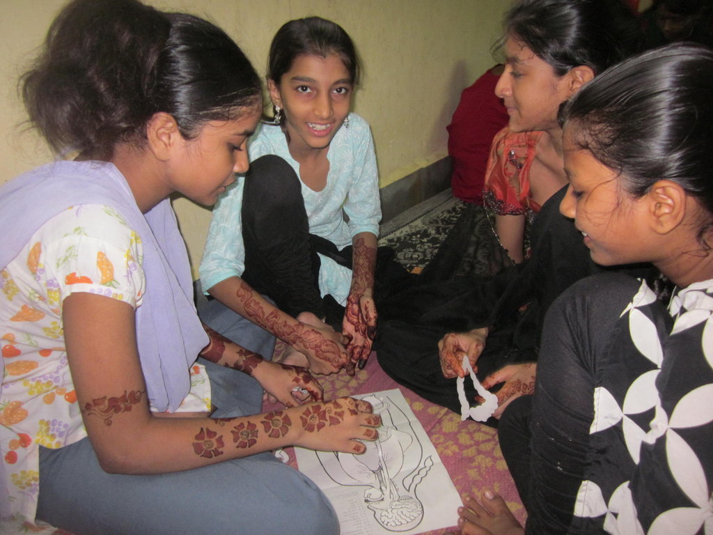 Girls learning about body parts in health workshop