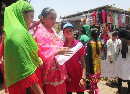 Girls collect Signatures during Rally