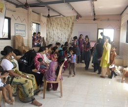 Waiting for their turn- health check up at Malwani