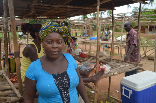 Isha's mother Tokumbo at the marketplace