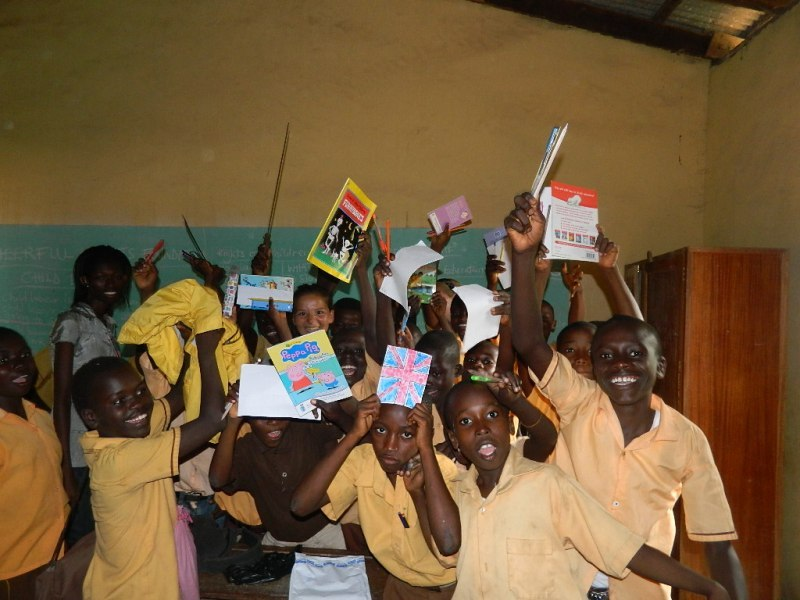 children excited after receiving books from team