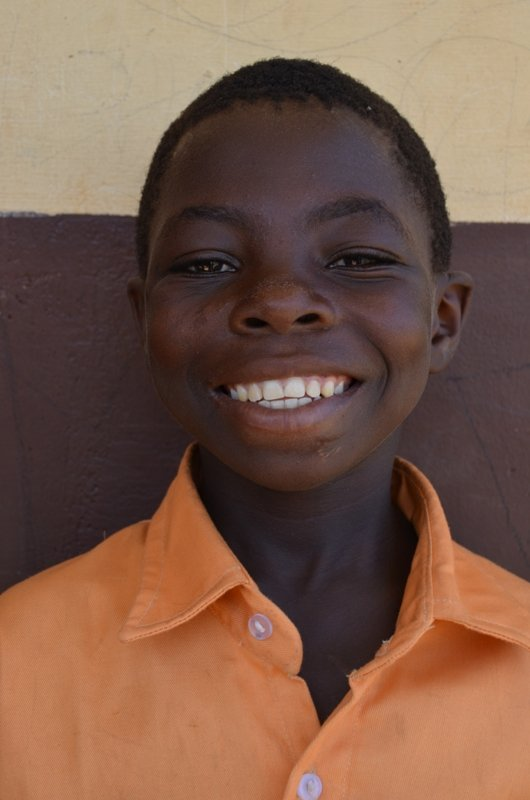 Emmanuel after being sponsored to school