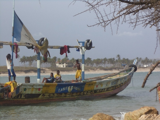 some children at work in the fishing boat