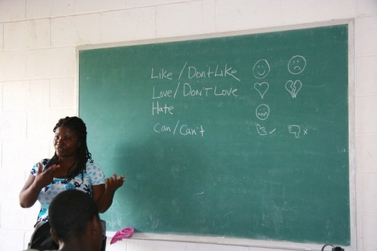 Lynda, one of the Haitian teachers, leads class