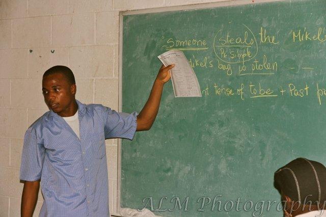 One of the Haitian teachers teaching