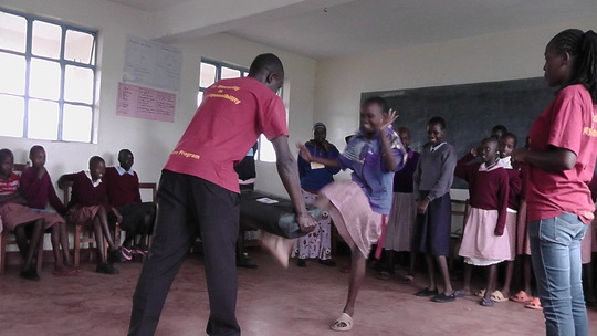 Girls practicing self defense moves