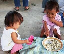 Filipino children eating mungbeans & rice