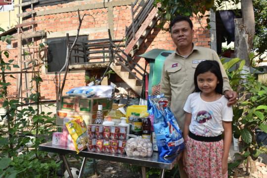 Deminer Rathana receiving essential supplies