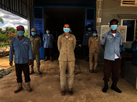 Cambodia staff social distancing with masks