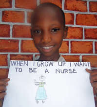 Lakiel holding a picture of herself as a nurse.