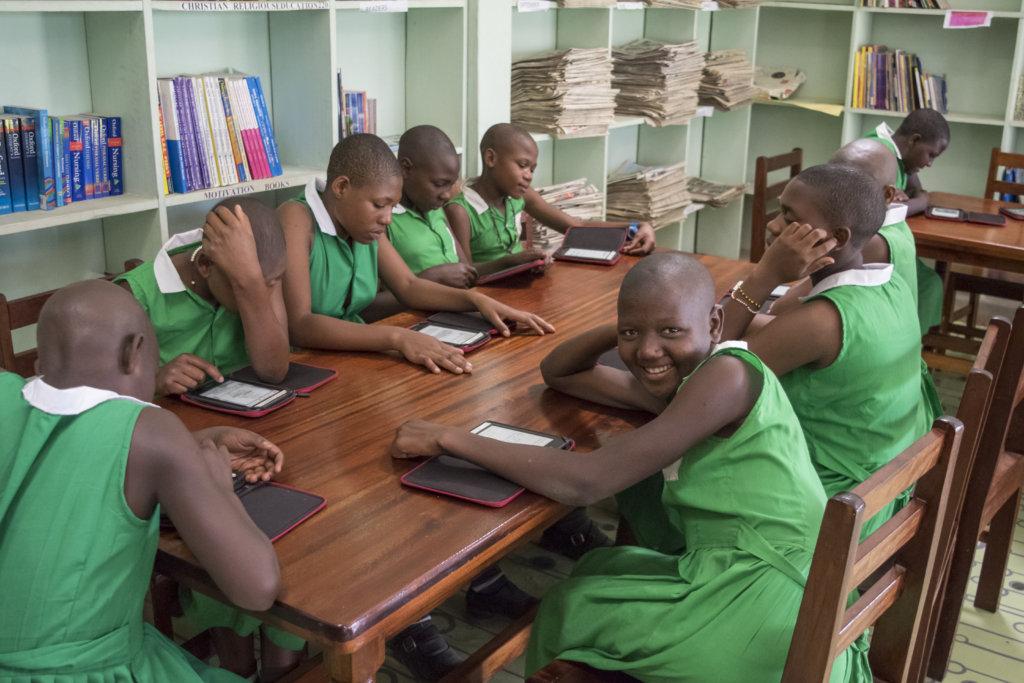 Kutamba students using e-readers