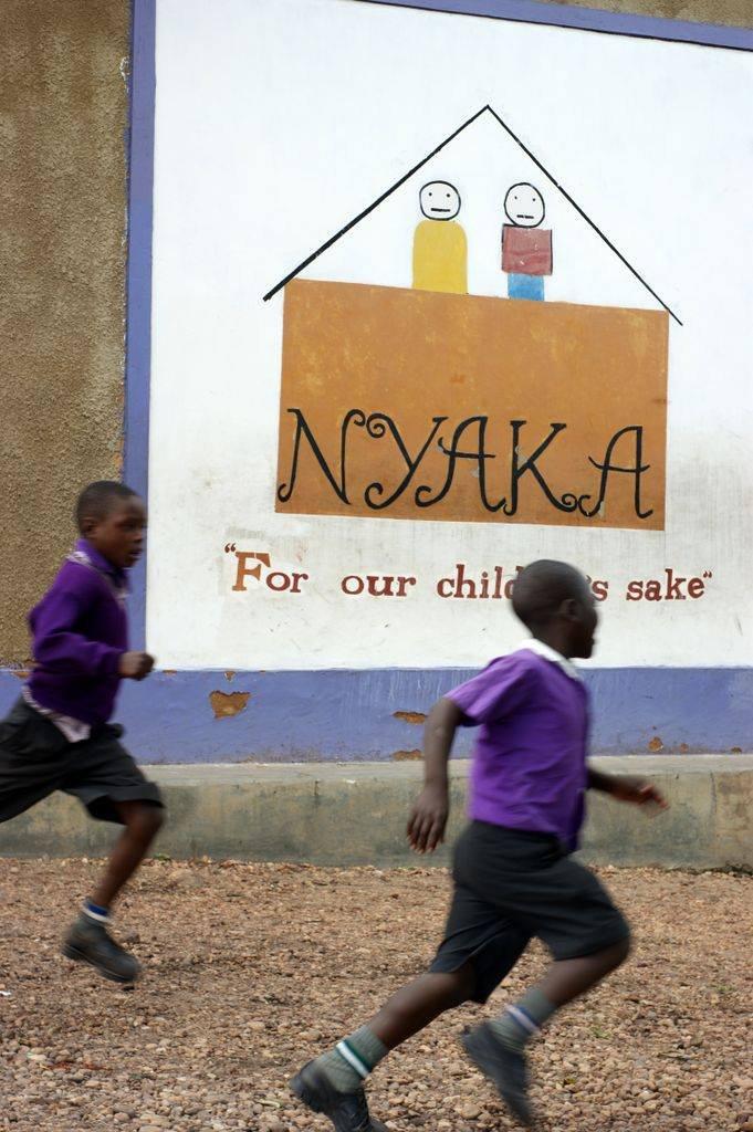 Children running and playing at Nyaka Primary.