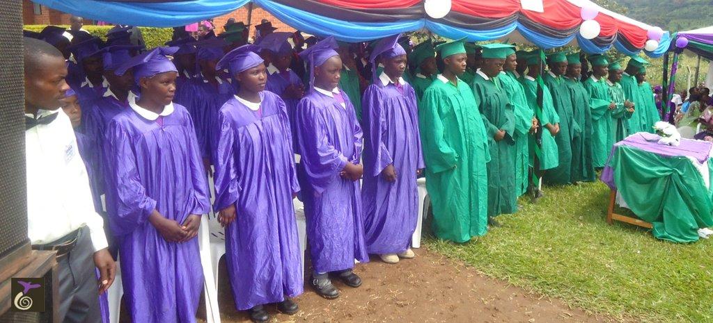 Grauating Girls Standing Beside Their Male Peers
