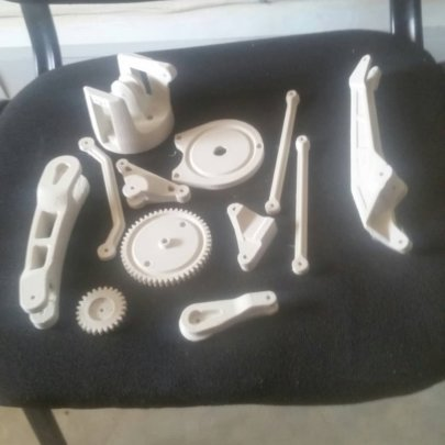Robotic arm pieces ready to be assembled