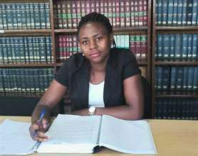 Sarah in the library at school