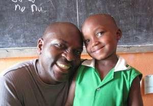 Founder Twesigye with a Kutamba Student