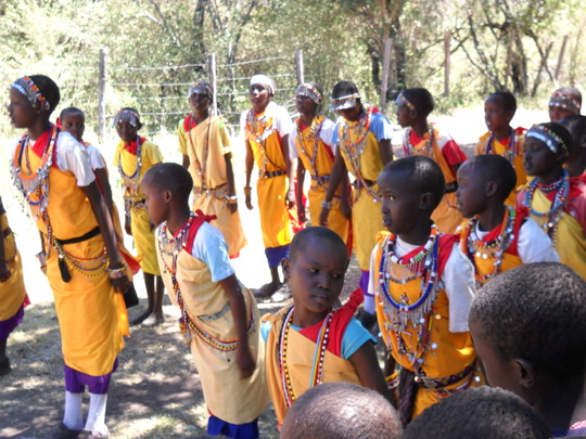 Students performing in traditional garb
