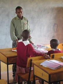 David instructing 5th grade students in English