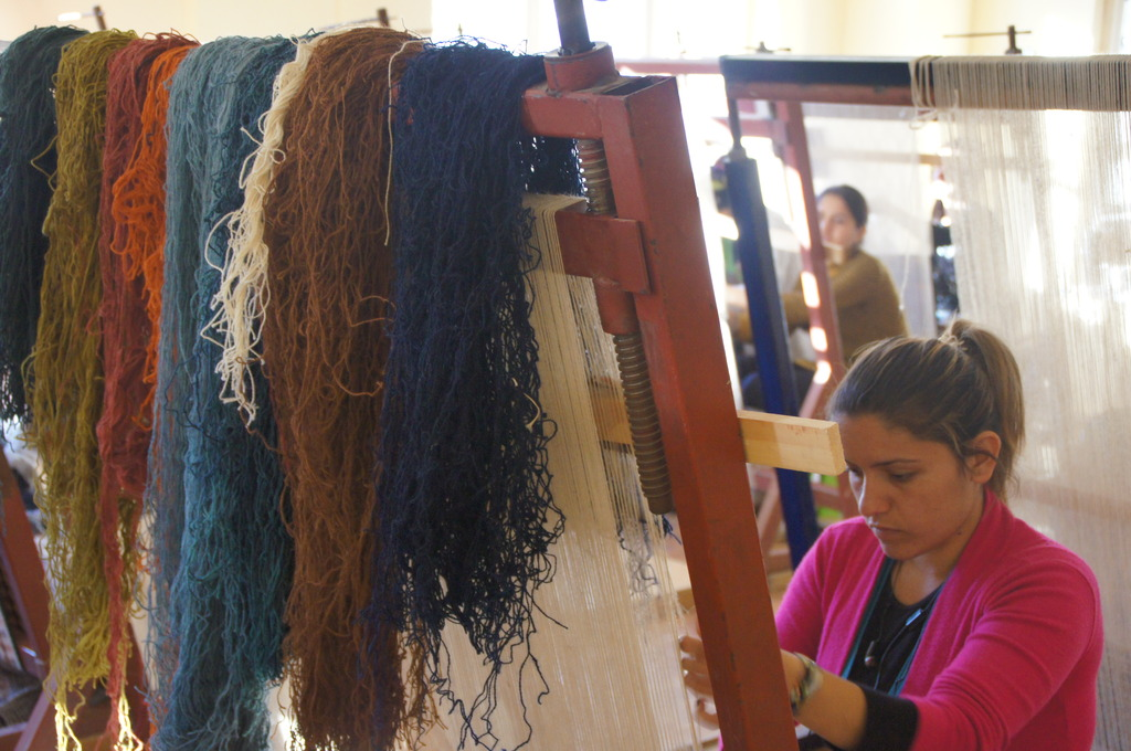 A Young Woman in Van Weaves at a Kilim