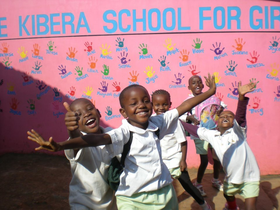 This photo shows a group of our students playing and goofing around outside the school in Kibera, Kenya.