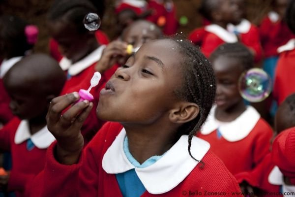 Natasha was caught blowing bubbles after school outside the Kibera School for Girls.