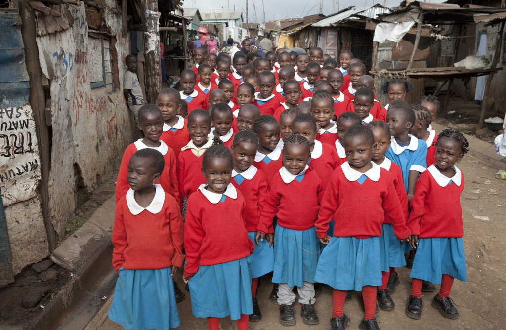 This is a photo of our original first grade class standing in the streets of Kibera, on their way to the newly built Kibera School for Girls.