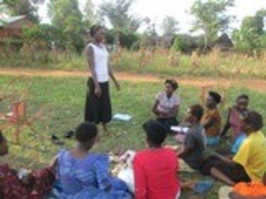 Namukose teaching young women in her community