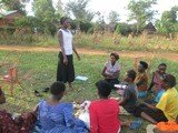 Namukose teaching young women in her community